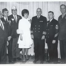 1970 Nov 22 - Opening Day Visitors(9)LtoR-Arthur Dow-BOD, Fred Wanner-Secretary, Phil Ploumen-Tres, Maggie Purdem, Capt B.B.Pererson-Nav&MarTrng, Chief Justin, USMC guest, & Board VP Maj Braudtner