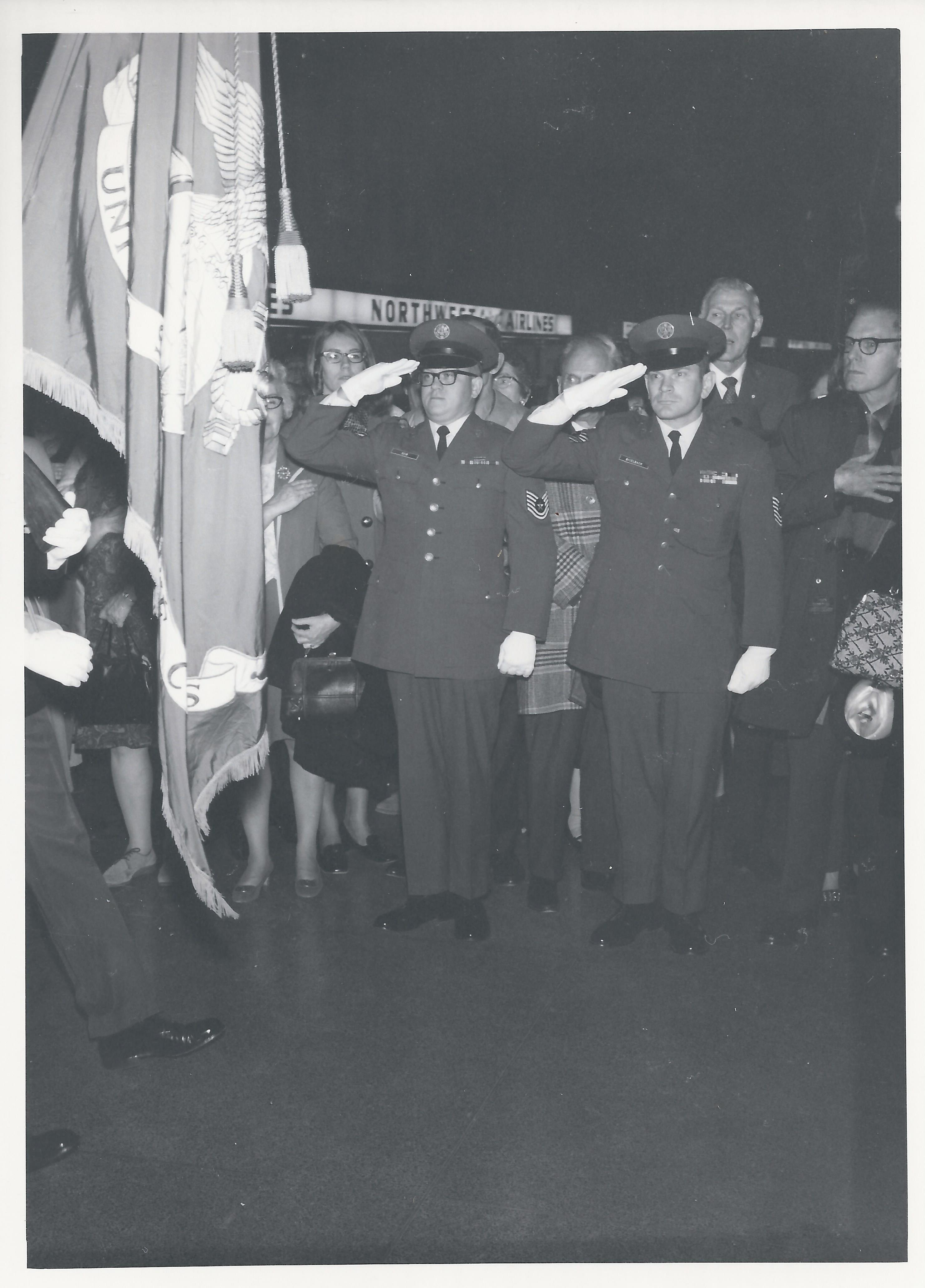 1970 Nov 22 - Troops saluting at opening day event