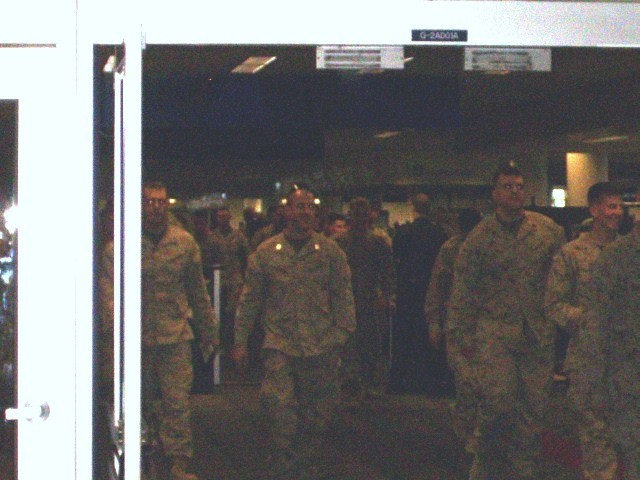 """AFSC Volunteers join NWA and TSA staff, to """"welcome"""" Marines to the MSP Airport."""